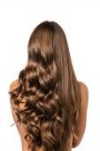 zadní pohled na dívku s kudrnaté a rovné dlouhé hnědé vlasy, izolované na bílém