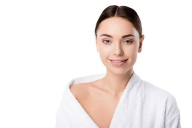 attractive smiling woman in bathrobe looking at camera isolated on white