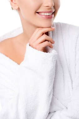 cropped view of woman in bathrobe touching chin isolated on white