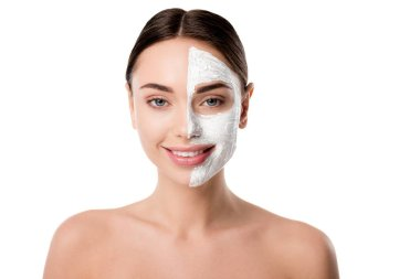 Smiling nude woman with facial skin care mask looking at camera isolated on white stock vector