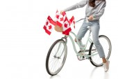 Fotografie cropped view of woman riding vintage bicycle with canadian flags isolated on white