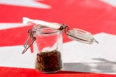 Fotografie cannabis in glass jar with joint on canadian flag, marijuana legalization concept