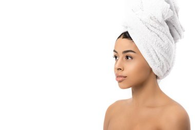 Portrait of beautiful pensive african american girl with towel on head looking away isolated on white stock vector