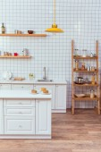 Fotografie modern kitchen design with wooden shelves and white tile on background