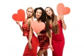 Photo beautiful multiethnic girls holding cardboard hearts, pouting lips and posing isolated on white