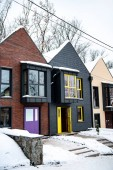stylish modern houses in cold winter with snow on ground