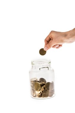 cropped view of woman taking golden coin from glass jar isolated on white