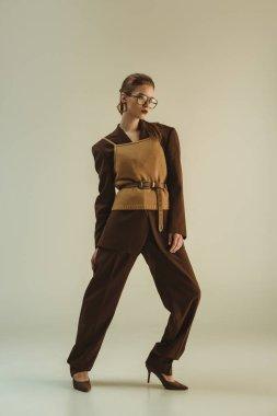 Beautiful girl posing in trendy vintage clothing on beige stock vector