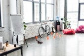 modern design of spacious loft office with flip chart, bicycle and copy space