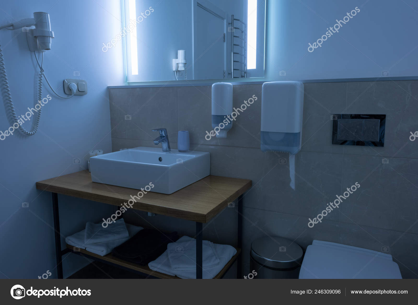 Bathroom Washstand Toilet Towels Hair Dryer Stock Photo