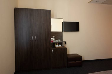 hotel room interior with wardrobe and mirror
