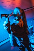 attractive blonde dj girl drinking wine from bottle