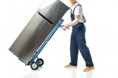 cropped view of mover in uniform transporting refrigerator on hand truck isolated on white