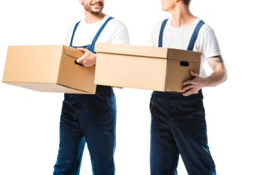 Cropped view of two movers transporting cardboard boxes isolated on white stock vector