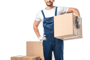 cropped view of mover in uniform carrying cardboard box isolated on white with copy space