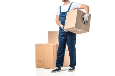 Cropped view of mover in uniform carrying cardboard box isolated on white with copy space stock vector
