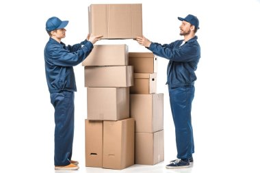 Two movers in uniform holding cardboard box on white stock vector