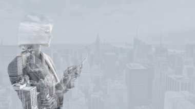 double exposure of businesswoman using smartphone and new york cityscape