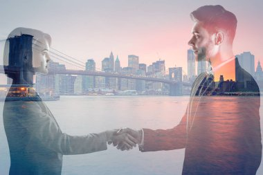 double exposure of man and woman shaking hands and looking at each and new york evening cityscape