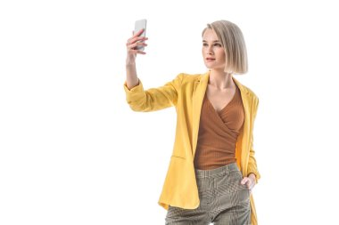 Beautiful blonde woman taking selfie with smartphone isolated on white stock vector