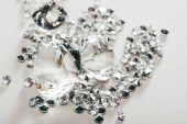 selective focus of transparent pure big diamonds among small on white background