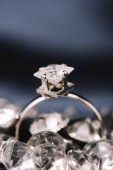Photo selective focus of engagement ring with shiny diamond