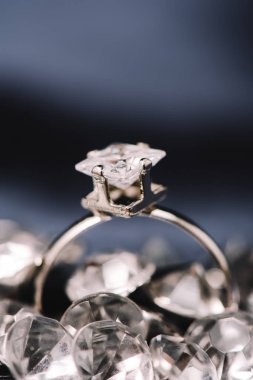 selective focus of engagement ring with shiny diamond