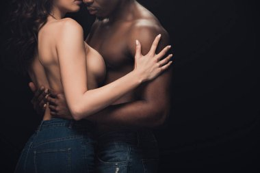 cropped view of half-naked interracial couple embracing isolated on black with copy space