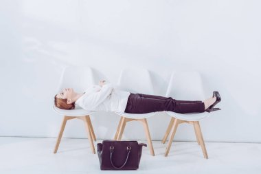 Attractive employee lying on chairs while waiting job interview stock vector