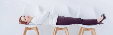 panoramic shot of employee lying on chairs while waiting job interview