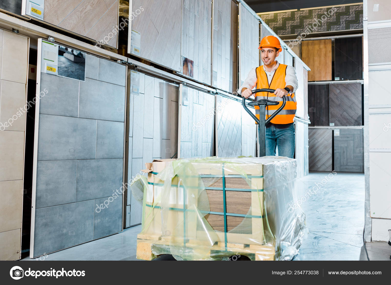 Smiling Warehouse Worker Carrying Pallet Jack Tiles Department