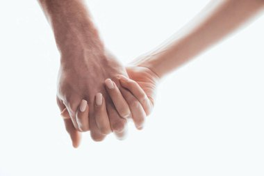 Partial view of man and woman holding hands isolated on white
