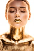 naked woman with closed eyes painted in golden isolated on white