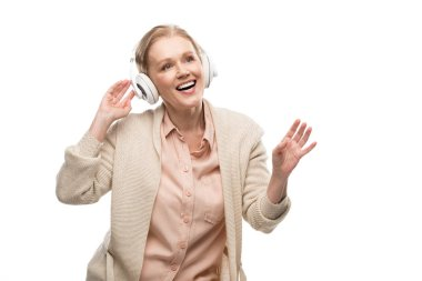 smiling middle aged woman in headphones listening music Isolated On White