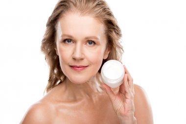 beautiful nude mature woman holding container with cosmetic cream Isolated On White