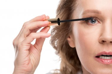 Cropped view of mature woman applying mascara Isolated On White stock vector