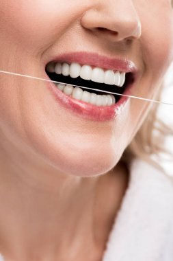 cropped view of middle aged woman using dental floss Isolated On White