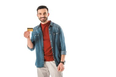 Smiling man holding credit card while looking at camera isolated on white stock vector