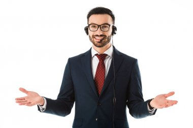 handsome call center operator in headset smiling and showing idea gesture isolated on white