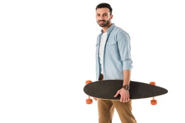 Handsome smiling man holding longboard and looking at camera isolated on white stock vector