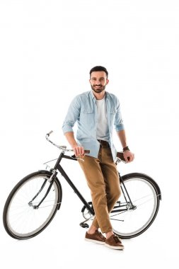 Handsome bearded man with bicycle smiling and looking at camera isolated on white stock vector