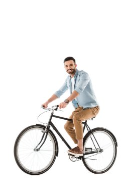 Cheerful bearded man riding bicycle and smiling at camera isolated on white stock vector