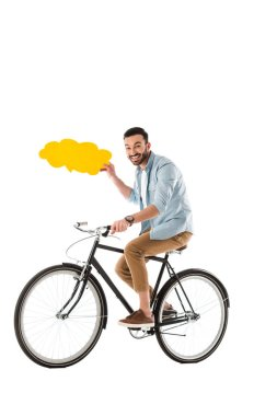 Cheerful man riding bicycle while holding thought bubble isolated on white stock vector