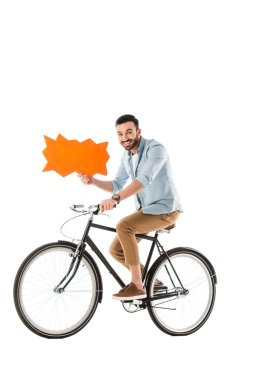 happy handsome man riding bicycle while holding thought bubble isolated on white