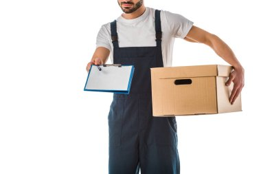 Partial view of delivery man with cardboard box holding clipboard with blank paper isolated on white stock vector