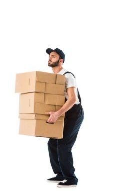 Handsome serious delivery man carrying carton boxes isolated on white stock vector