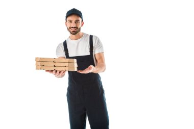 Cheerful delivery man holding pizza boxes and smiling at camera isolated on white stock vector