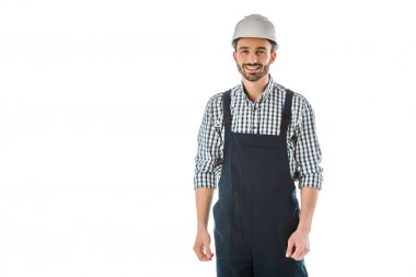 Smiling construction worker in overalls and helmet looking at camera isolated on white stock vector