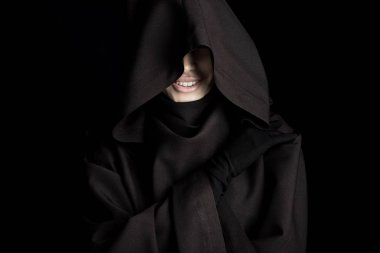 Smiling woman in death costume isolated on black stock vector