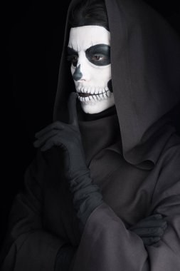 woman with skull makeup showing hush sign isolated on black